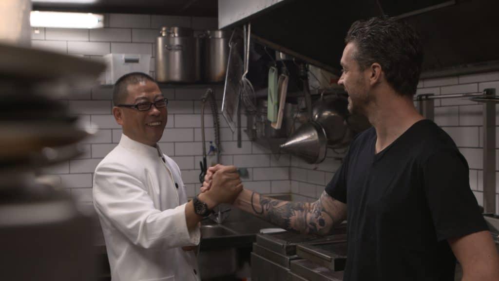 Chef Exchange chefs Jock Zonfillo & Qu Jianmin handshake