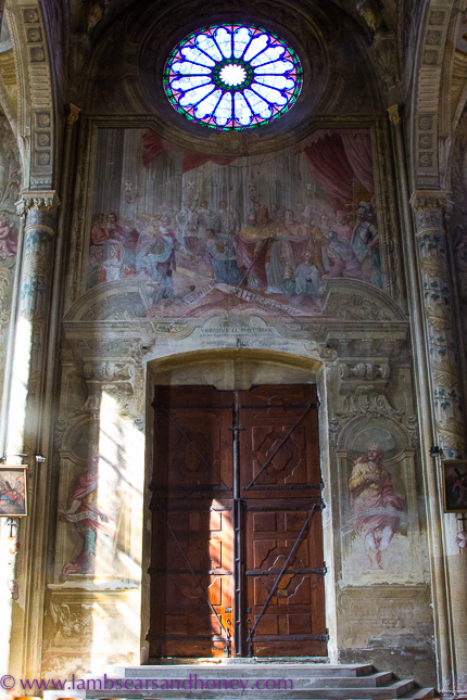 frescoes around the door of Asti Cathedral