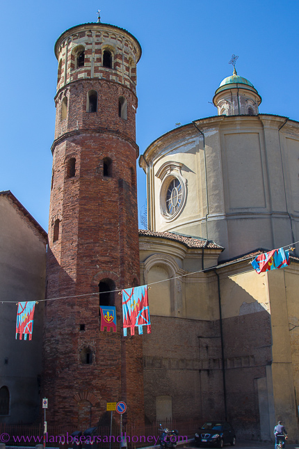 Borough flags hanging in the streets of Asti