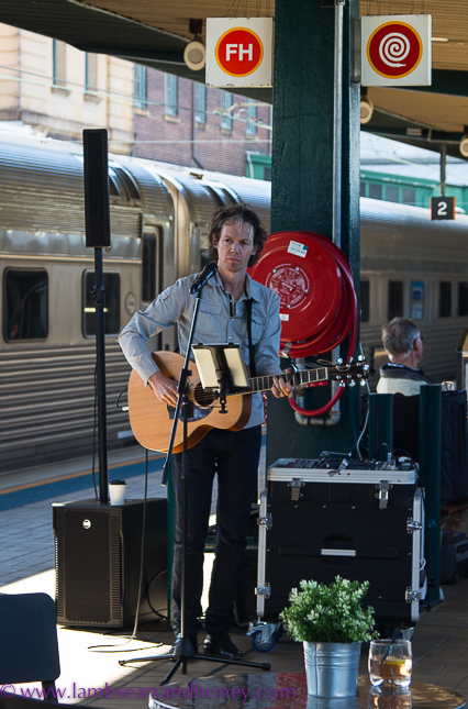 Guitarist on the platform, indian pacific