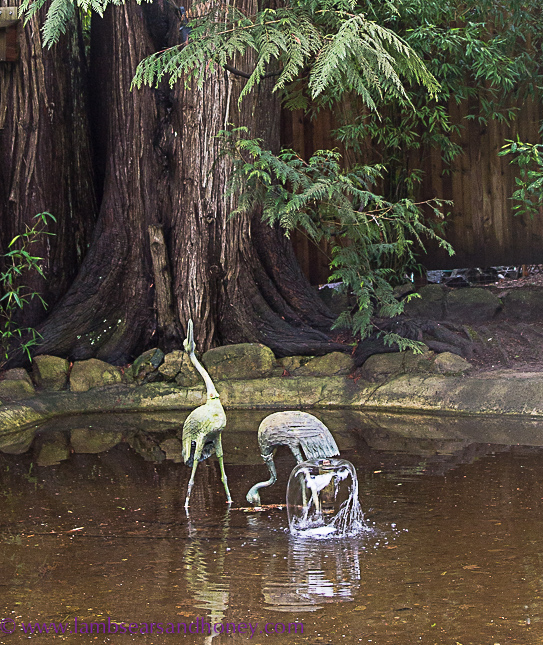 Statues and pond Butchart Gardens on Vancouver Island