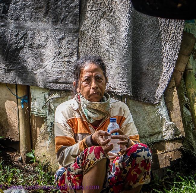 luxury accommodation in bali - local lady, four seasons sayan